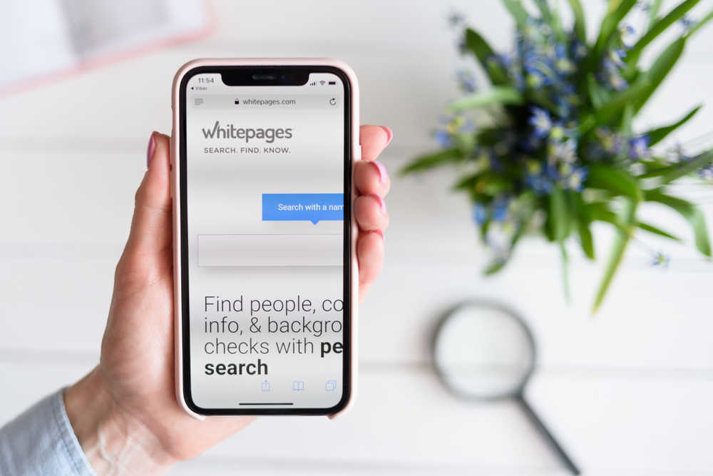 how to remove your information from WhitePages on phone screen