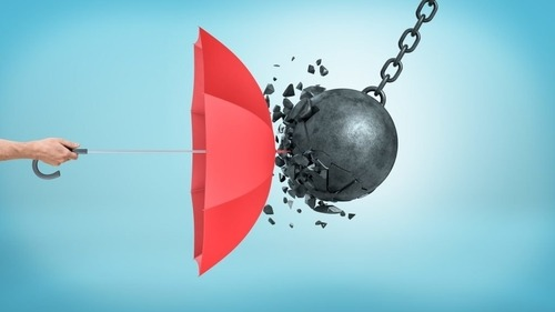 Wrecking Ball Crashing into Umbrella