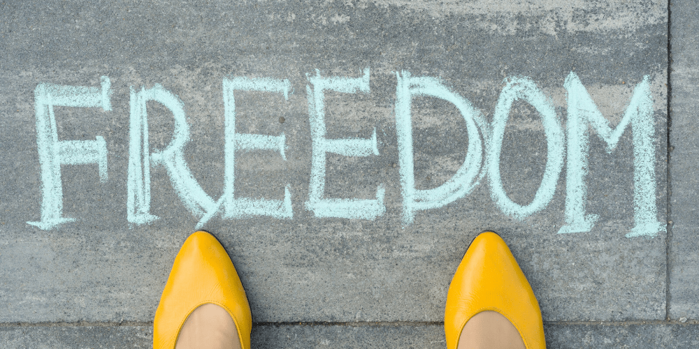 freedom written in chalk with yellow heels